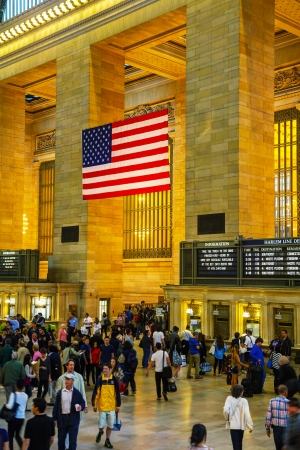 NEW YORK CITY - MAY 11: Grand Central Terminal with people on May 12, 2013  in New York City. It's the largest train station in the world by number of platforms and the world's number six most visited tourist attraction, bringing in approximately 21,600,0