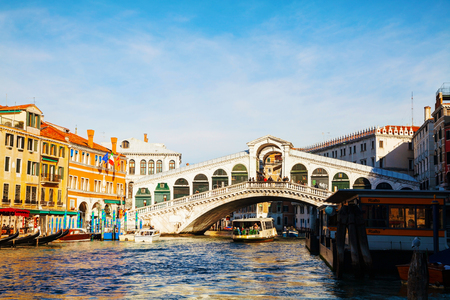 rialto: VENICE - DECEMBER 11: Rialto Bridge (Ponte Di Rialto) on a sunny day with tourists on December 11, 2012 in Venice. Its oldest and one of the four bridges spanning the Grand Canal in Venice.