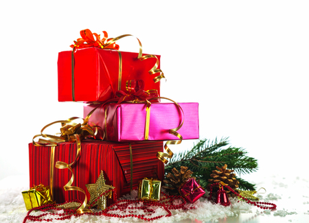 Christmas presents with evergreen branches Imagens