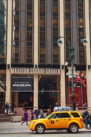 NEW YORK CITY - MAY 11: Madison Square Garden with people on May 11, 2013 in New York City. Madison Square Garden is a multi-purpose indoor arena in midtown Manhattan in New York City.