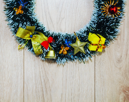 Christmas wreath over wooden Banco de Imagens