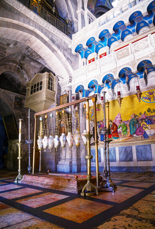 JERUSALEM - DECEMBER 13: Interior of the Church of Holy Sepulcher on December 16, 2013 in Jerusalem. Its the site venerated as Golgotha (the Hill of Calvary), where Jesus was crucified.