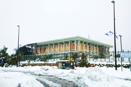 The Knesset in Jerusalem, Israel covered with snow photo