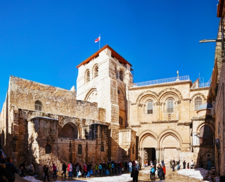 golgotha: JERUSALEM - DECEMBER 16: Entrance to the Church of Holy Sepulcher on December 16, 2013 in Jerusalem. Its the site venerated as Golgotha (the Hill of Calvary), where Jesus was crucified. Editorial