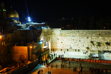 JERUSALEM - DECEMBER 15: The Western Wall in the night on December 13, 2013 in Jerusalem. Its located in the Old City of Jerusalem at the foot of the western side of the Temple Mount.