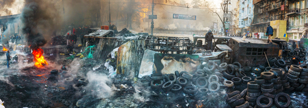 provoked: KIEV, UKRAINE - JANUARY 24  Overview of the barricade at Hrushevskogo street on January 24, 2014 in Kiev, Ukraine  The anti-governmental protests were provoked when the Ukrainian president denied to sign an agreement with the EU