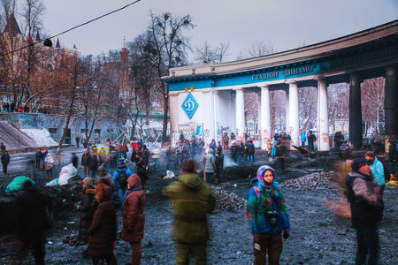 provoked: KIEV, UKRAINE - JANUARY 24  Protesters at Hrushevskogo street on January 24, 2014 in Kiev, Ukraine  The anti-governmental protests were provoked when the Ukrainian president denied to sign an agreement with the EU
