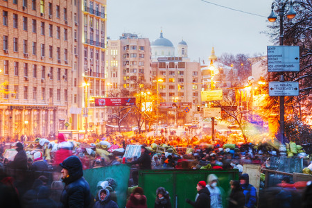 provoked: KIEV, UKRAINE - JANUARY 23  Overview of the barricade at Hrushevskogo street on January 23, 2014 in Kiev, Ukraine  The anti-governmental protests were provoked when the Ukrainian president denied to sign an agreement with the EU  Editorial