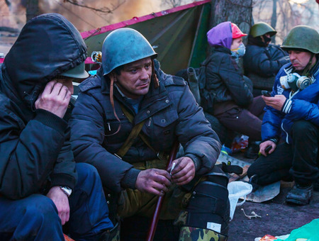 provoked: KIEV, UKRAINE - FEBRUARY 20  People at the barricade on February 20, 2014 in Kiev, Ukraine  The protests were provoked when the Ukrainian president denied to sign an agreement with the EU  Editorial