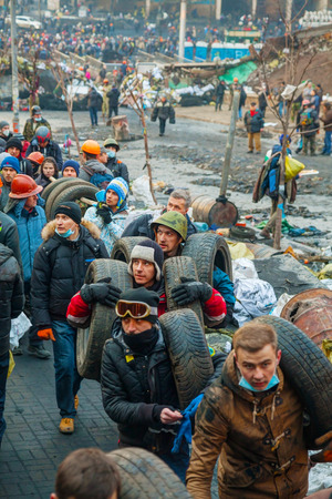 provoked: KIEV, UKRAINE - FEBRUARY 20  People at the barricades on February 20, 2014 in Kiev, Ukraine  The protests were provoked when the Ukrainian president denied to sign an agreement with the EU