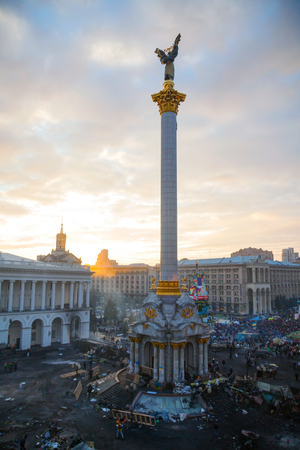 provoked: KIEV, UKRAINE - FEBRUARY 20  Maidan  Independence  square after the revolution on February 20, 2014 in Kiev, Ukraine  The anti-governmental protests were provoked when the Ukrainian president denied to sign an agreement with the EU