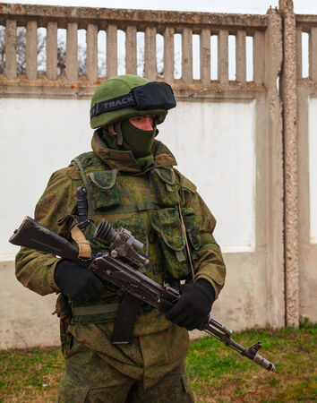 PEREVALNE, UKRAINE - MARCH 4  Russian soldier on March 4, 2014 in Perevalne, Crimea, Ukraine  On February 28, 2014 Russian military forces invaded Crimea peninsula  Stock Photo - 26410697
