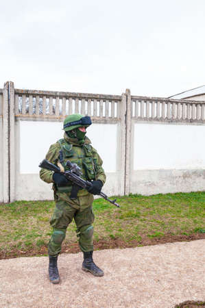 PEREVALNE, UKRAINE - MARCH 4  Russian soldier marching on March 4, 2014 in Perevalne, Crimea, Ukraine  On February 28, 2014 Russian military forces invaded Crimea peninsula  Stock Photo - 26410698