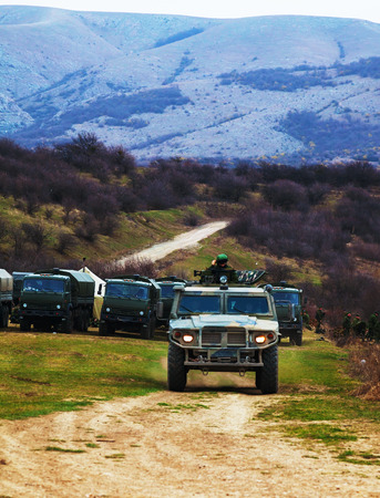 invaded: PEREVALNE, UKRAINE - MARCH 5  Russian armoured truck on March 5, 2014 in Perevalne, Crimea, Ukraine  On February 28, 2014 Russian military forces invaded Crimea peninsula