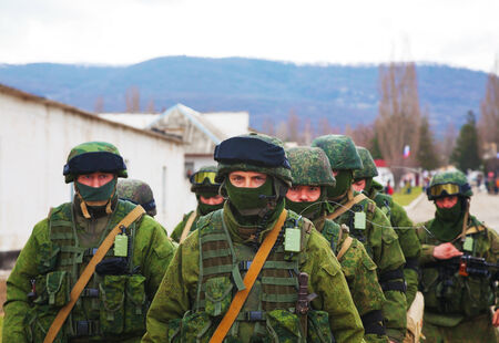 invaded: PEREVALNE, UKRAINE - MARCH 5  Russian soldiers marching on March 5, 2014 in Perevalne, Crimea, Ukraine  On February 28, 2014 Russian military forces invaded Crimea peninsula