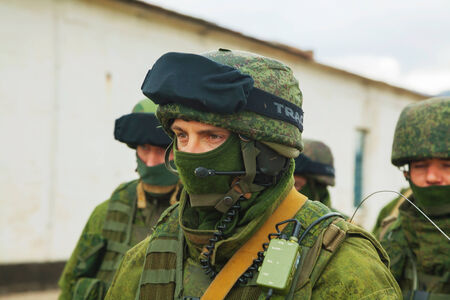 invaded: PEREVALNE, UKRAINE - MARCH 5  Russian soldier on March 5, 2014 in Perevalne, Crimea, Ukraine  On February 28, 2014 Russian military forces invaded Crimea peninsula