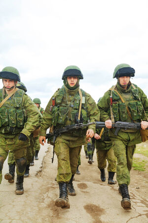 PEREVALNE, UKRAINE - MARCH 5  Russian soldiers marching on March 5, 2014 in Perevalne, Crimea, Ukraine  On February 28, 2014 Russian military forces invaded Crimea peninsula  Stock Photo - 26410703