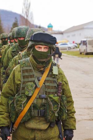 invade: PEREVALNE, UKRAINE - MARCH 5  Russian soldiers marching on March 5, 2014 in Perevalne, Crimea, Ukraine  On February 28, 2014 Russian military forces invaded Crimea peninsula