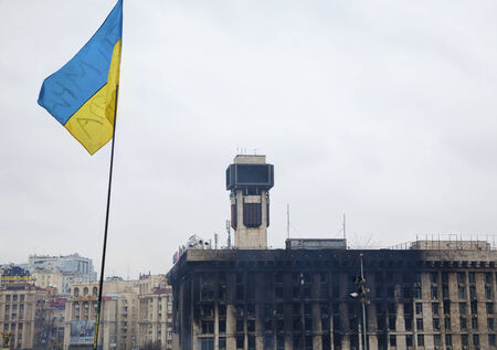 provoked: KIEV, UKRAINE - FEBRUARY 27  Ukrainian flag at Maidan  Independence  square on February 27, 2014 in Kiev, Ukraine  The anti-governmental protests were provoked when the Ukrainian president denied to sign an agreement with the EU