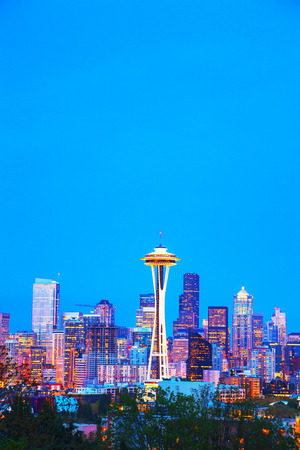 Downtown Seattle cityscape with Space Needle at night time as seen from the Kerry park