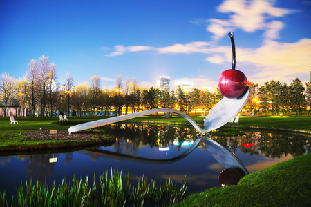 MINNEAPOLIS - MAY 14: The Spoonbridge and Cherry at the Minneapolis Sculpture Garden on May 14, 2014 in Minneapolis, MN. It is one of the largest urban sculpture gardens in the country, with 40 permanent art installations and several other temporary piece