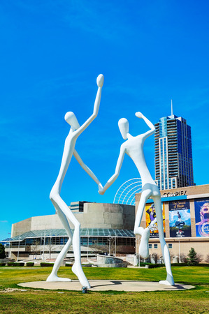 DENVER - May 1, 2014: The Dancers public sculpture on May 1, 2014 in Denver, Colorado. The Dancers was permanently installed in front of the Denver Performing Arts Complex on June 12, 2003.
