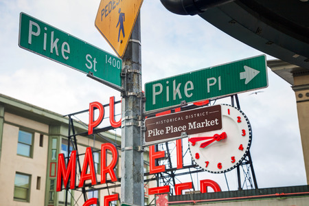 pike place market sign: SEATTLE - MAY 9: Famous Pike Place market street sign on May 9, 2014 in Seattle, WA. The Market opened in 1907, and is one of the oldest continuously operated public farmers markets in the US.