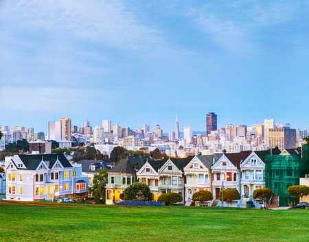 city park skyline: San Francisco cityscape with the Painted Ladies as seen from Alamo square park Stock Photo