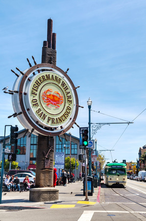 western united states: SAN FRANCISCO - APRIL 24: Famous Fishermans Wharf sign with tourists on April 24, 2014 in San Francisco, California. Its one of the busiest and well known tourist attractions in the western United States.