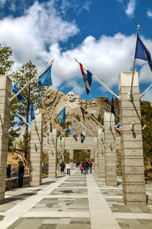 thomas stone: KEYSTONE, SD - MAY 10: Mount Rushmore monument with tourists on May 10, 2014 near Keystone, SD. Its a sculpture carved into the granite features 60-foot sculptures of the heads of 4 US presidents.