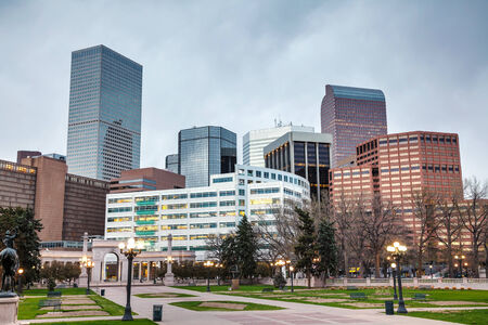 denver skyline at sunset: Downtown Denver cityscape in the evening Stock Photo
