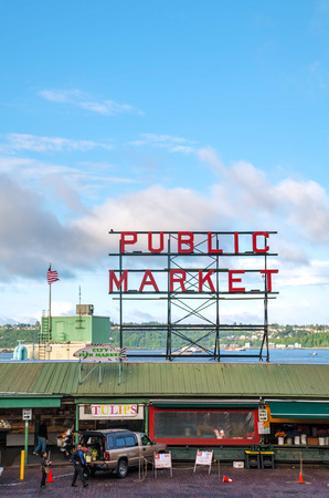 SEATTLE - MAY 9: Famous Pike Place market sign on May 9, 2014 in Seattle, WA. The Market opened in 1907, and is one of the oldest continuously operated public farmers markets in the US. Editorial