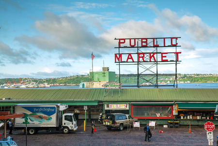 public market sign: SEATTLE - MAY 9: Famous Pike Place market sign on May 9, 2014 in Seattle, WA. The Market opened in 1907, and is one of the oldest continuously operated public farmers markets in the US. Editorial