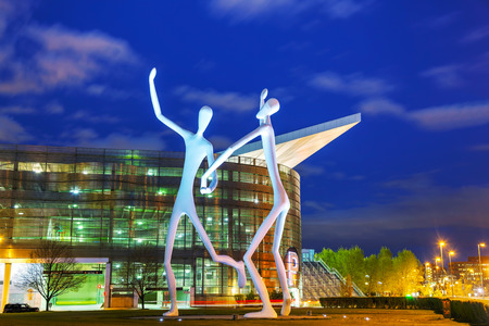 DENVER - May 1, 2014: The Dancers public sculpture at night time on May 1, 2014 in Denver, Colorado. The Dancers was permanently installed in front of the Denver Performing Arts Complex on June 12, 2003.