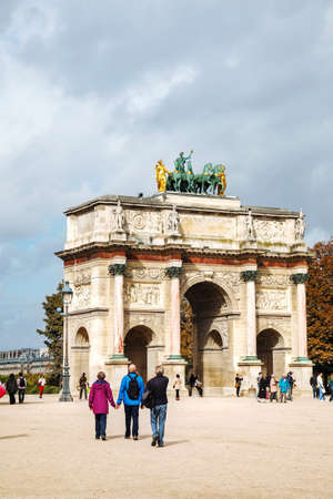 carrousel: PARIS - OCTOBER 9: Arc de Triomphe du Carrousel on October 9, 2014 in Paris, France. Its a triumphal arch, located in the Place du Carrousel built between 1806 and 1808 to commemorate Napoleons military victories of the previous year