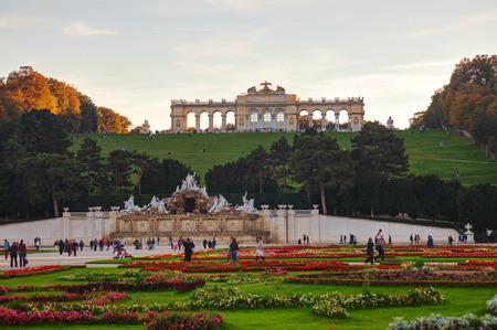 gloriette: VIENNA - OCTOBER 19: Gloriette Schonbrunn at sunset with tourists on October 19, 2014 in Vienna. Its the largest gloriette in Vienna built in 1775 as the last building constructed in the Schonbrunn garden.