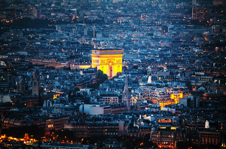 Aerial view of Arc de Triomphe de l'Etoile (The Triumphal Arch) in Paris at night