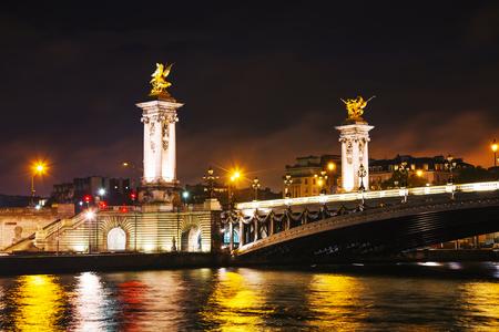 Alexander III bridge in Paris at night photo