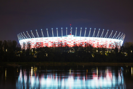 WARSAW - October 1: National stadium at night on October 1, 2014 in Warsaw, Poland. The stadium has a seating capacity of 58,145 which makes it the largest association football arena in Poland.