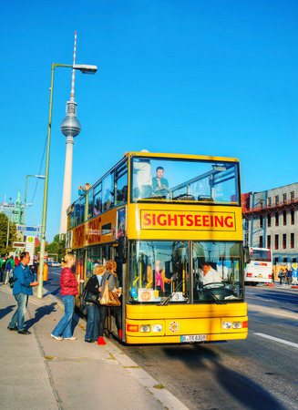 BERLIN - OCTOBER 3, 2014: Touristic bus at Berliner Dom on October 3, 2014 in Berlin, Germany. Berliner Dom is the short name for the Evangelical Supreme Parish and Collegiate Church. It is located on Museum Island in the Mitte borough.