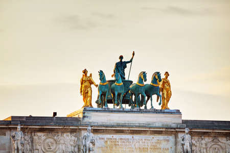 carrousel: Sculpture of the chariot on top of the Arc de Triomphe du Carrousel in Paris Stock Photo