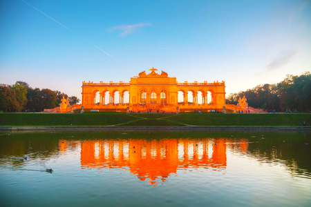 schonbrunn palace: VIENNA - OCTOBER 19: Gloriette Schonbrunn at sunset with tourists on October 19, 2014 in Vienna. Its the largest gloriette in Vienna built in 1775 as the last building constructed in the Schonbrunn garden.