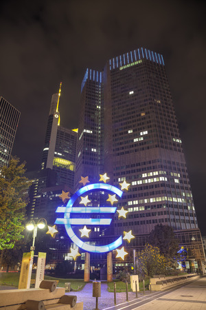 monetary policy: FRANKFURT - OCTOBER 14: Euro sign in front of the European Central Bank building on October 14, 2014 in Frankfurt, Germany. Its the central bank for the euro and administers monetary policy of the Eurozone.