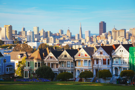 San Francisco cityscape with the Painted Ladies as seen from Alamo square park Фото со стока