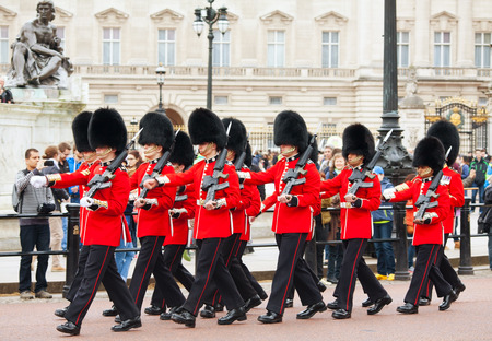 st jamess: LONDON - APRIL 13: Queens Guards at the Buckingham palace on April 13, 2015 in London, UK. Its the name given to the contingent of infantry guarding Buckingham Palace and St Jamess Palace.