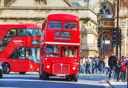 archetypal: LONDON - APRIL 12: Iconic red double decker bus on April 12, 2015 in London, UK. The London Bus is one of Londons principal icons, the archetypal red rear-entrance Routemaster being recognised worldwide.