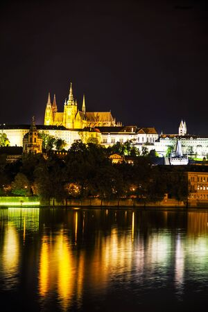 historical reflections: Old Prague cityscape at the night time Editorial
