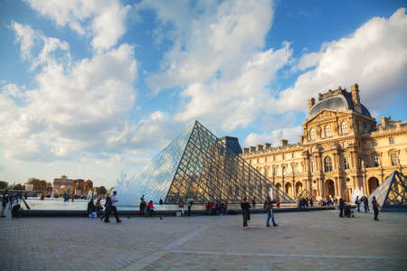 louvre pyramid: PARIS - OCTOBER 9: The Louvre Pyramid on October 9, 2014 in Paris, France. It serves as the main entrance to the Louvre Museum. Completed in 1989 it has become a landmark of Paris.