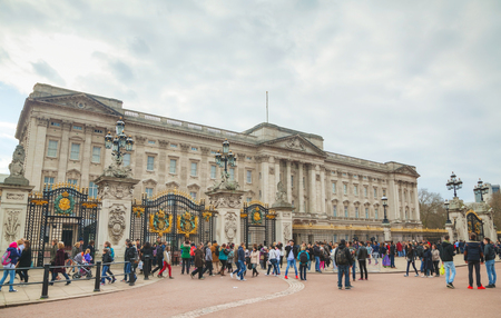monarchy: LONDON - APRIL 5: Buckingham palace with tourists on April 5, 2015 in London, UK. Its the London residence and principal workplace of the monarchy of the United Kingdom. Editorial