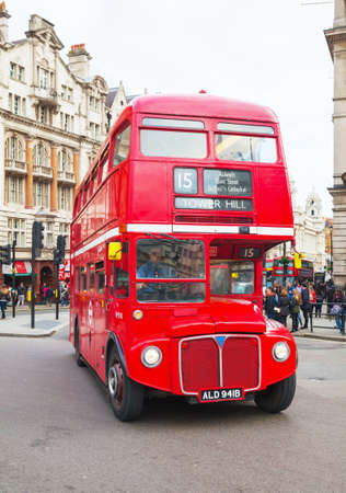 archetypal: LONDON - APRIL 5: Iconic red double decker bus on April 5, 2015 in London, UK. The London Bus is one of Londons principal icons, the archetypal red rear-entrance Routemaster being recognised worldwide. Editorial